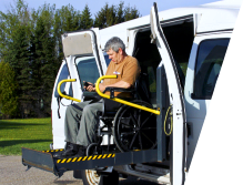 disabled man using a wheelchair lift