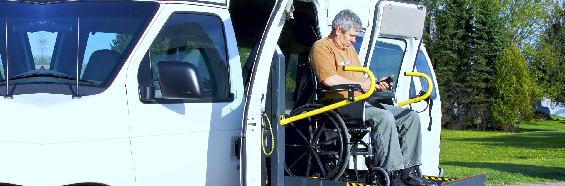 old man in a wheelchair using a wheelchair lift